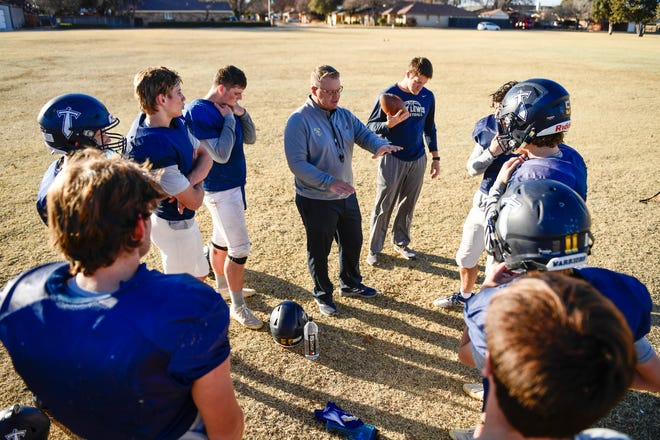 Kingdom Prep coach Jeff Klein talks to his team during practice last season at South Plains Church of Christ. The Warriors are projected to again play for the state championship this fall.