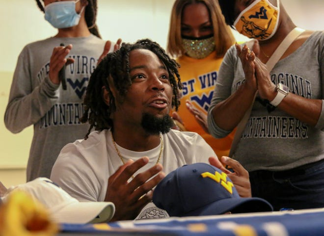 Auburndale linebacker Aubrey Burks reacts after signing with West Virginia on Wednesday afternoon at a signing ceremony at the Lake Mirror Center in Lakeland.