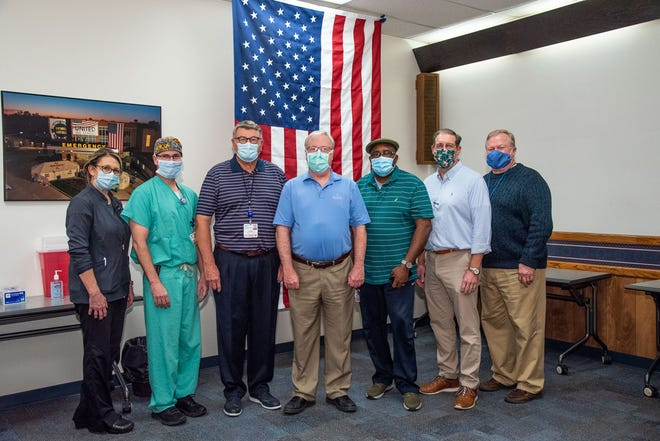 Left to right: Wanda Foster, MDH Vice President/Chief Nursing Officer; Dr. Shea Trost; Dr. Jack McPherson; Dr. Edwin Card; Dr. Ken Nwafo; Dr. Curtis Farr; Brian E. Dietz, FACHE, MDH President/CEO