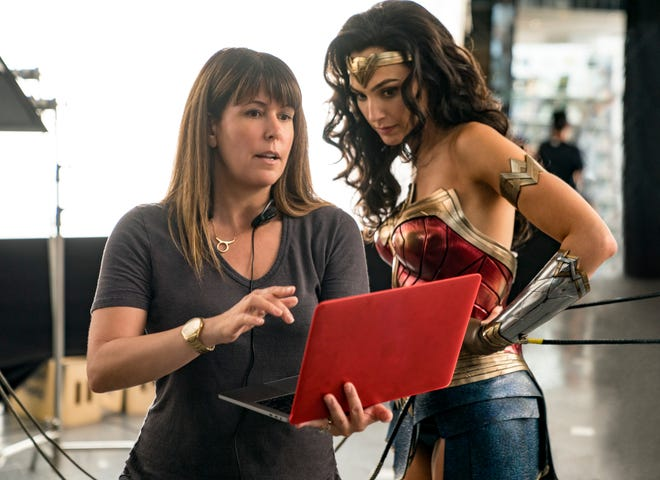 """Wonder Woman"" director Patty Jenkins discusses a scene with Gal Gadot, right."