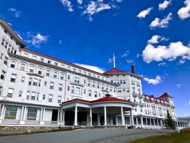 The exterior of the Mount Washington Hotel hasn't changed too much, but the original roof was green. Carolyn Stickney had it changed to red to make the place pop against the landscape.