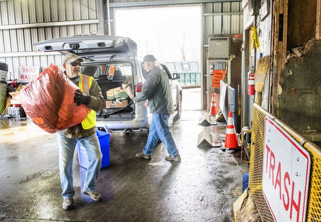 Portsmouth Recycling Coordinator Ray Antaya, left, helps Cliff Curtis unload garbage at the Portsmouth transfer station in 2018.