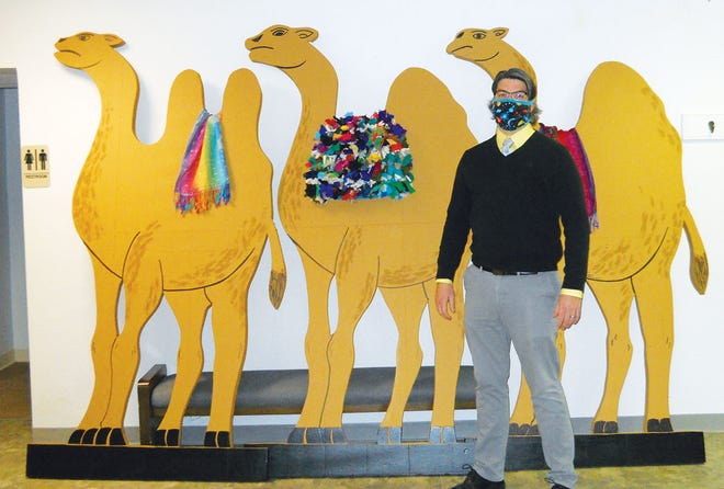 Rory Naeve, pastor of First Baptist Church of Oak Ridge, stands in front of the camels that will be part of the 'Visit of the Magi' scene in the Drive-Thru Nativity this Saturday, Dec. 19. Nine Oak Ridge churches are involved. People can drive by the churches to view each scene. It's a free event.