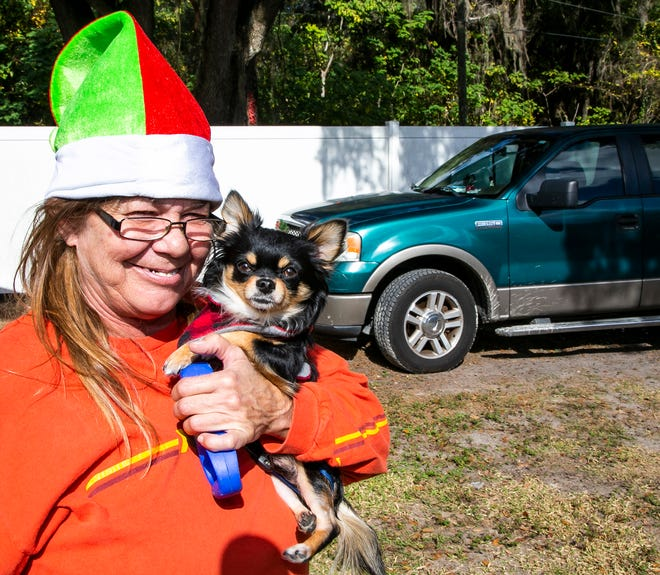 Jennifer Hemphill, 55, holds her long-haired chihuahua, Boo Boo, last week at the Saving Mercy RV Park in Ocala. Hemphill is thankful for Community With A Heart's $1,200 donation and another $600 from an anonymous donor to get her 2006 Ford F150 fixed.