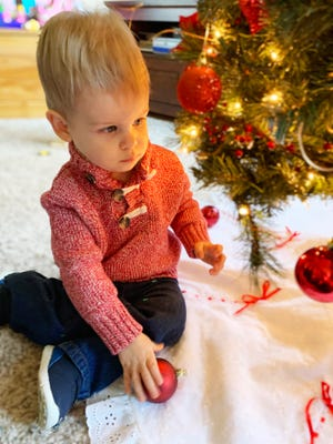 Knox Iskrzycki, 1, checks out the decorations on the family Christmas tree. Soon, he will be checking out the presents underneath the tree. Knox's parents are Amy and Kurt Iskrzycki of Pontiac.