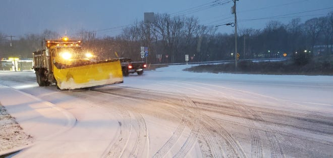 A plow truck hits the streets in Smithfield Township on Wednesday.