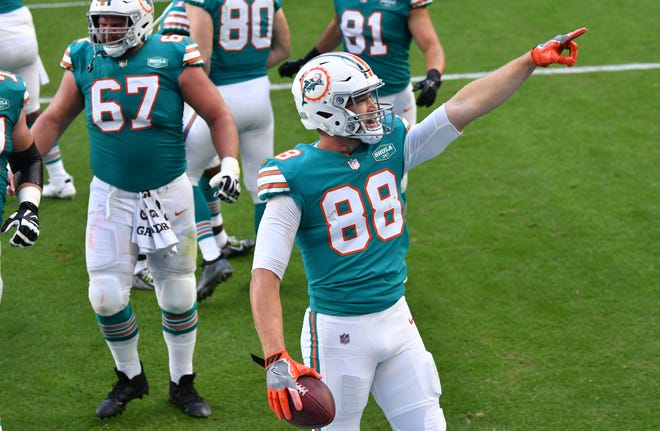 Dolphins tight end Mike Gesicki points to the crowd after scoring a touchdown in the first half against the Kansas City Chiefs.