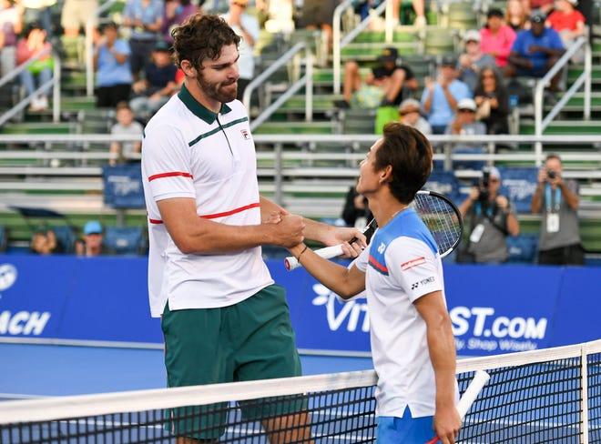 Delray Beach resident Reilly Opelka (left) and Yoshihito Nishioka shake hands after Opelka won last year's tournament.