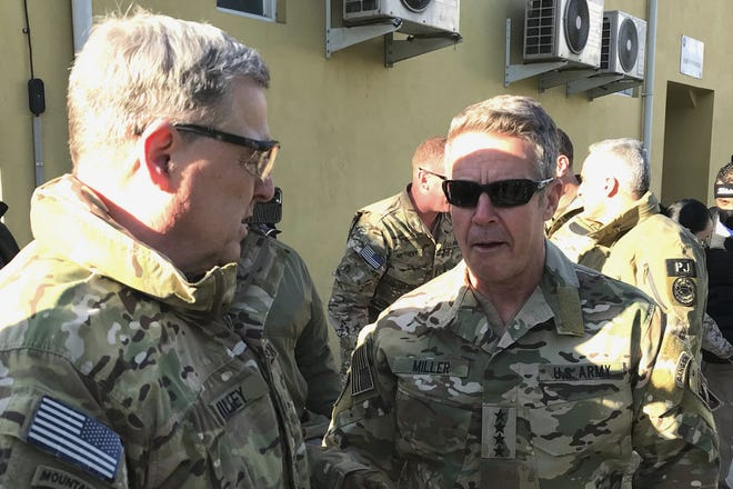 Chairman of the U.S. Joint Chiefs of Staff Gen. Mark Milley, left, talks with Gen. Scott Miller, the commander of U.S. and coalition forces in Afghanistan last week at Miller's military headquarters in Kabul, Afghanistan. [AP Photo/Robert Burns]