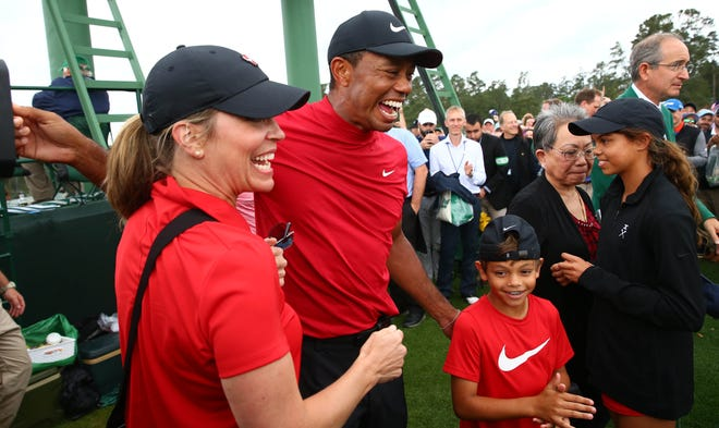 Tiger Woods and his son, Charlie, seen here celebrating Tiger's Masters victory last year in Augusta, Georgia, will be competing as a father-son team for the first time this weekend in Orlando.