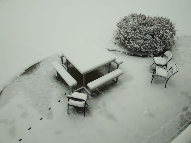 A backyard picnic spot seems frozen in time Thursday morning after a slow-moving snow storm dumped several inches of snow in southcentral Kansas overnight.