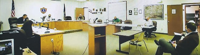Social distancing and masks were the order of business for the December 7 Pratt City Commission meeting, which was also broadcast as a Zoom session. (From left) City Attorney Regina Probst, Commissioner Zach Deeds, Mayor Gary Schmidt, Commissioner Gary Meyer, City Manager Bruce Pinkall, Police Chief Nate Humble and audience members, commissioners-elect Jeanette Siemens and Kyle Farmer took part in the meeting.