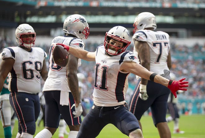 New England Patriots wide receiver Julian Edelman celebrates a touchdown at Hard Rock Stadium in Miami Gardens, Florida, on December 9, 2018.