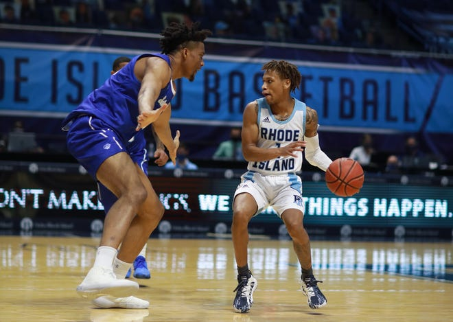 URI's Fatts Russell, right, shown playing against Seton Hall, is dealing with a heel injury. The Rams open Atlantic 10 play Friday vs. Davidson.