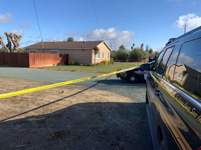 San Joaquin County Sheriff's Office officials investigate at the scene of a suspected double homicide on West Kingdon Road in Lodi on Thursday morning. According to authorities, a person went into their grandparents' home to find two people unresponsive just after 8 a.m.