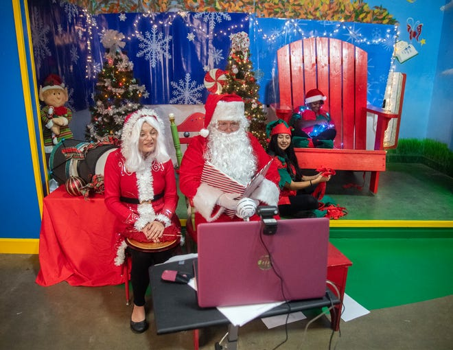 Children's Museum of Stockton Executive Director Marianne Prieto-Harrold, left, and her husband, Bob Harrold, portray Santa and Mrs. Claus during the museum's virtual Santa visits for children.