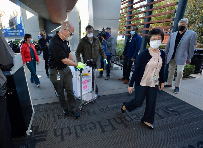 Doses of the Pfizer BioNTech COVID-19 vaccine arrive at Providence St. Joseph Hospital in Orange, Calif. on Wednesday.