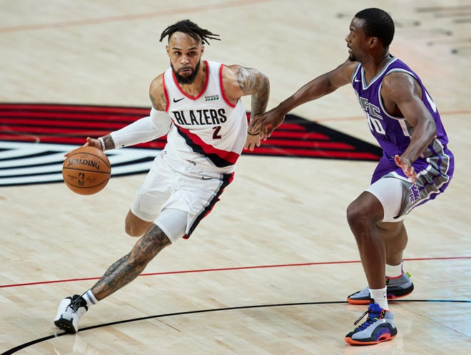 Portland's Gary Trent Jr. (2) drives past Sacramento's Harrison Barnes during a Dec. 13 preseason game in Portland. The Trail Blazers continue their preseason schedule Friday at Denver.