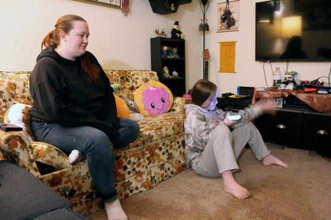 Taylor Wood sits next to her 10-year-old daughter, Freya Wood, in their Corvallis apartment on Dec. 11. The family has missed three months of rent payments during the pandemic and faces eviction if a moratorium is not extended.