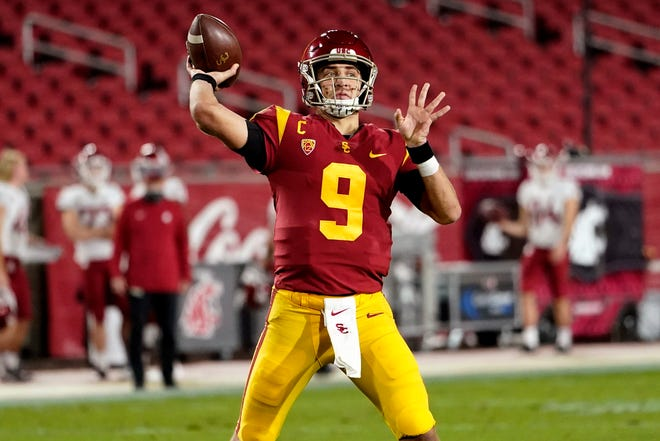 USC quarterback Kedon Slovis leads the Pac-12's top-ranked passing attack. The Trojans will host Oregon in Friday's Pac-12 championship game.