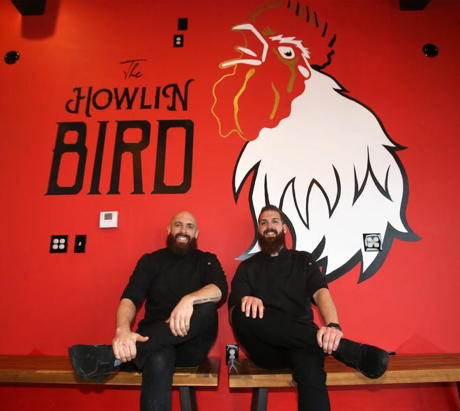 Nael Taki (left) and his brother, Samm, inside The Howlin Bird in downtown North Canton.