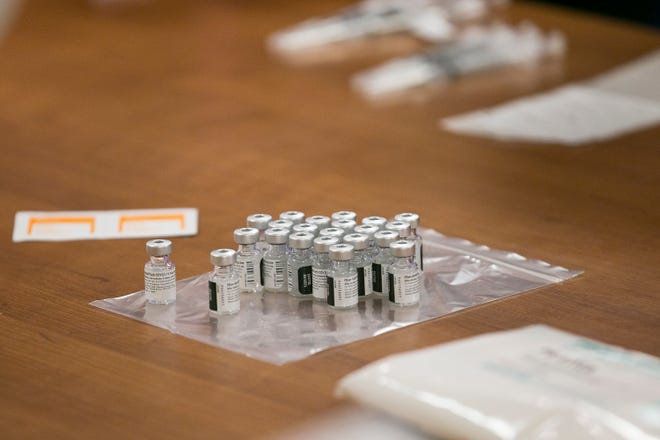 Vials of the Pfizer-BioNTech COVID-19 vaccine are prepared at SwedishAmerican Hospital on Dec. 17 in Rockford. Pfizer and Moderna's vaccines are in use in Stephenson County.