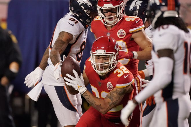 Kansas City Chiefs strong safety Tyrann Mathieu (32) intercepts a pass from Denver Broncos quarterback Drew Lock in the first half of a game Dec. 6 in Kansas City, Mo.