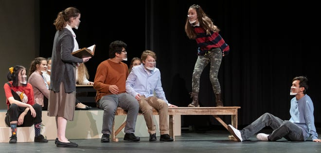 """Mia Dennett, left, a junior who plays Grace Bradley, acts out a scene with Yesenia Torres, a junior who plays Gladys Herdman, who stands on a table during a scene in the upcoming Salina South's Theatre production of """"The Best Christmas Pageant Ever,"""" by Barbara Robinson. Due to the increase in the COVID-19 cases in Saline County the production was recorded and can be view online at 2 p.m. Dec. 19, 7 p.m. Dec. 19, and 2 p.m. Dec. 20."""