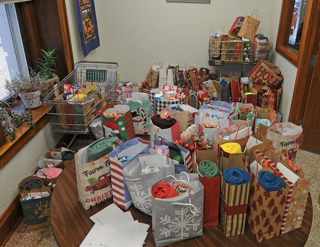 Christmas bags with essential items fill a room inside the Salina Senior Center before they were delivered to those seniors in need who are on the Meals on Wheels program.