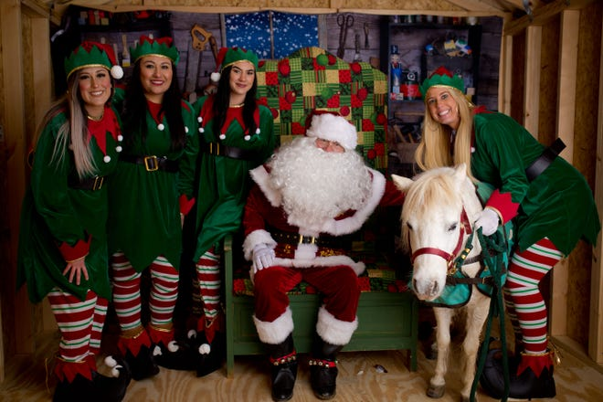 Nurture 'n Nature Child Care Center elves and their pony took time out to visit with Santa Claus on Monday during the Stephenville Chamber's Holly Jolly Christmas festival in downtown Stephenville.
