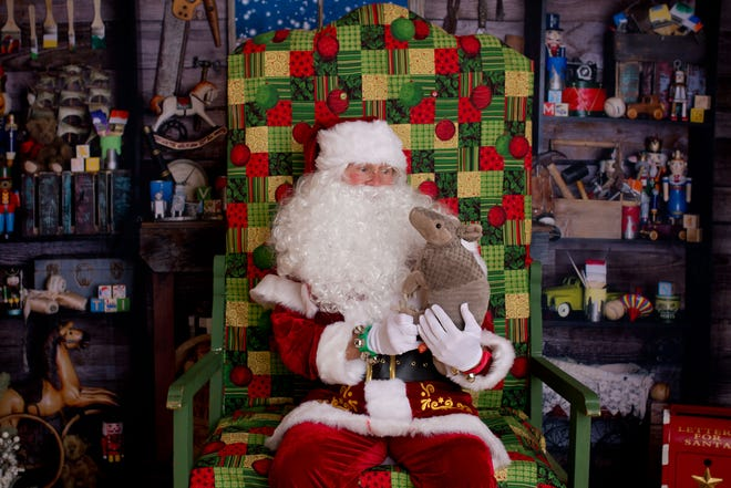 Santa Claus visited with kids --- and critters --- of all ages during Monday's Holly Jolly Christmas event in downtown Stephenville.