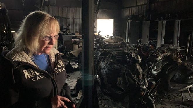 The charred remains are all that is left of some scooters, motorbikes and golf carts at Lem's Auto Sales off of U.S. 74 in Shelby. Tina Rachaels, Lem's wife, surveys the damage.