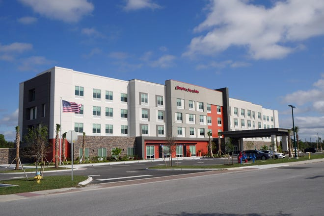 The new 100-room Hampton Inn & Suites opened for business Thursday at 5664 Tuscola Blvd., North Port. It's the first new hotel in the city since 1973.