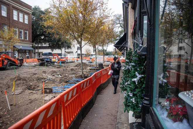 Visitors browse the windows of Ameila Island Soapery as they stroll along Broughton Street. Work for the Broughton Streetscapes project has closed off the entire block to traffic and reduced the amount of sidewalk available to walking traffic.