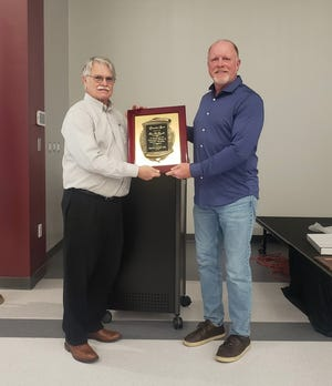 Ken McDowell, at left, was presented with the Citizen of the year award at a recent Kiwanis meeting. President Kevin Hannah is with him.