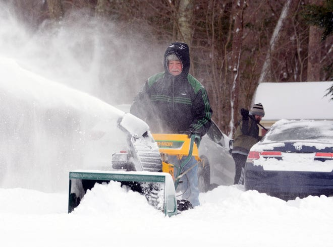 Tim Kyser snowplows his driveway as his son, Andrew Kyser, clears snow off family cars Thursday after the snowstorm in Colchester. See more photos at NorwichBulletin.com [John Shishmanian/ NorwichBulletin.com]