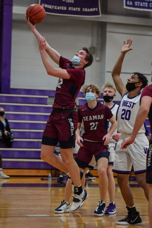 Seaman's Ty Henry (12) scored 18 second-half and overtime points to help lead the Vikings to a 66-63 double-overtime win over Highland Park on Tuesday. With two wins, Seaman has already matched last year's total.