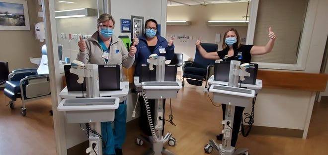 Mary Myers, RN, Risk Manager; Krystal Hilton, MSN, BSN, RN, Chief Nursing Officer; and Jennifer Robbins, MSN, RN, Director of Professional Practice, prepare to administer the first COVID-19 vaccines to employees at Morton Hospital in Taunton. The hospital received doses of the vaccine on Dec. 16.