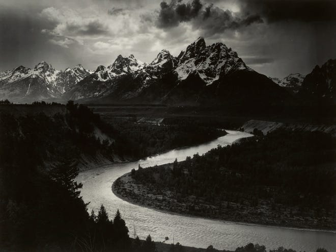 """This 1942 Ansel Adams photo provided by Sotheby's and The Ansel Adams Publishing Rights Trust shows a West Texas oilman's mural-sized print of Ansel Adams' photo, """"The Grand Tetons and the Snake River, Grand Teton National Park, Wyoming."""""""