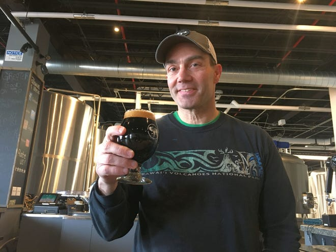 Greater Good Imperial Brewing Company owner Paul Wengender in his Worcester brewery and taproom. [T&G File Photo]