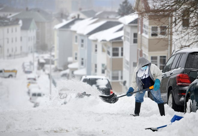 Ofori Anane shovels out his car on Seymour Street in the Vernon Hill neighborhood of Worcester during Thursday's snowstorm.
