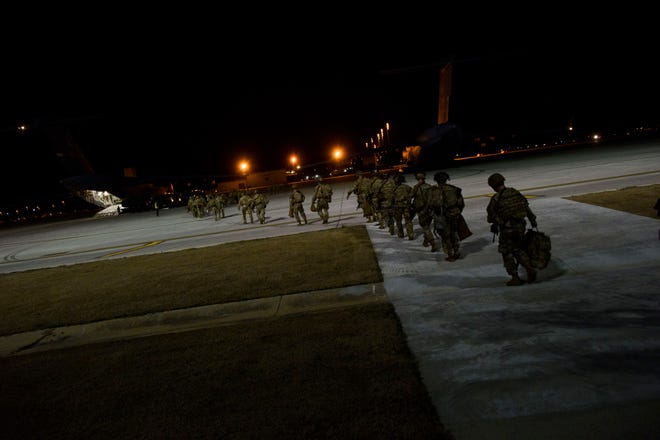 Paratroopers from 2nd Batallion, 504th Parachute Infantry Regiment, 1st Brigade Combat Team, 82nd Airborne Division board a C17 aircraft on Jan. 1, 2020, at Fort Bragg.  The soldiers were activated and deployed in response to the increased threat levels against U.S. personnel and facilities in Iraq.