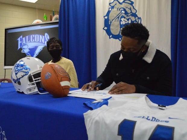 St. Pauls defensive lineman Enrique Lopez-Ray was one of four high school football players from Robeson County to sign with a Division I program on Wednesday. Ray was joined by his mother, Teresa.