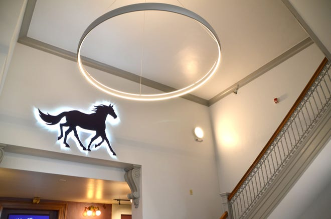 A new modern light fixture and the logo for the Hippodrome inside the foyer are some of the improvements made to the downtown theater to brighten the space. [Courtesy of the Hippodrome]