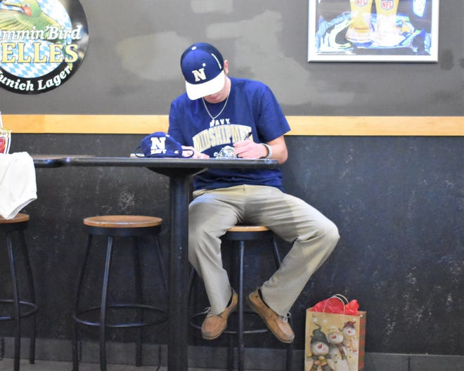 Southern Alamance's Stephen Glenn signs with Navy at a ceremony Wednesday night.