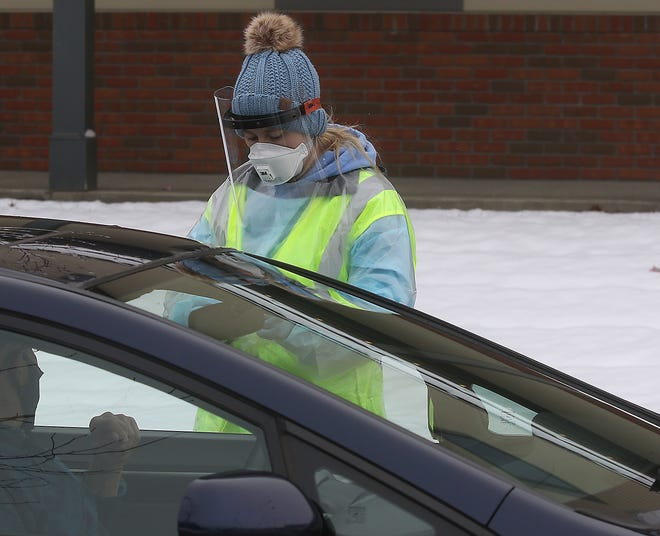 Personnel from the Community Family Health Center administered COVID-19 tests at a drive-thru site Thursday in the parking lot of the Ohio Star Theater.