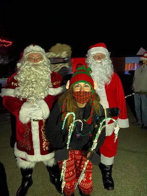 Not one, but two Santas showed up for the Melody in Motion visit to Riverside Manor Nursing and Rehabilitation Center in Newcomerstown. They are shown with Trisha Whitehawk, who organized the event.