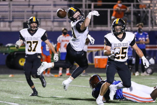 Upper Arlington's Jack Purcell (23) deflects a pass intended for Olentangy Orange's Rico Franklin (13) as teammates Adam Cipriano (37) and Shea Keethler (25) converge on the play Oct. 9 during the Division I first-round playoff game. The Bears won 17-10 before losing to Westerville Central 21-20 in the second round to finish 3-5.