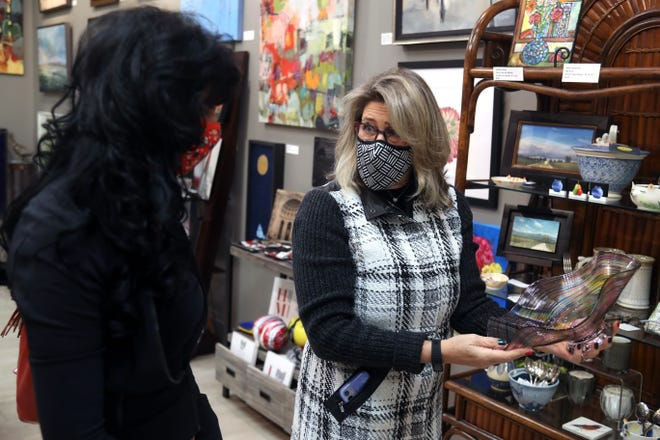 Hayley Deeter (right), owner of Hayley Gallery and Deeter Design, helps longtime customer and friend Karen Bishop of Westerville browse through the various items available at her New Albany business Dec. 16. Hayley Gallery was one of 30 local businesses to receive a grant from the $200,000 in Coronavirus Aid, Relief, and Economic Security Act funding distributed by New Albany.