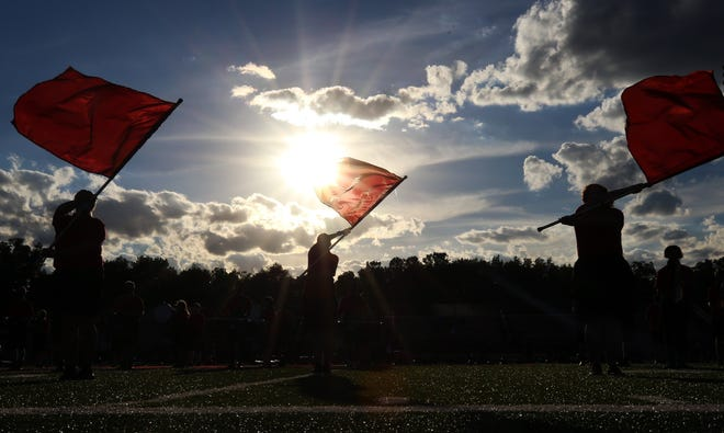 The Groveport Madison high school marching band performs before the Cruisers home football game against Reynoldsburg on Sept. 4.